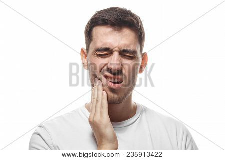 Closeup Of Young Man Isolated On White Background Touching His Face And Closing Eyes With Expression