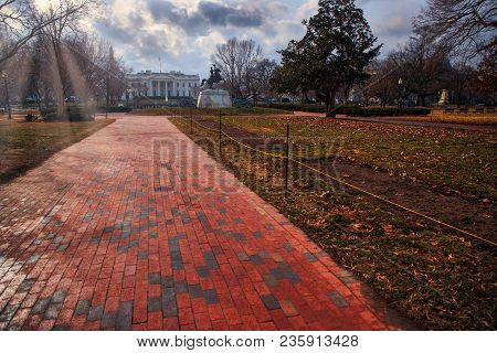 A Walkway In A Park Near The White House In Washington, Dc.