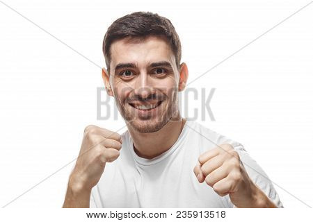 Strong Sporty Man Boxing, Looking At Camera With Smile. Close Up Portrait Of Smiling Young Man Keepi