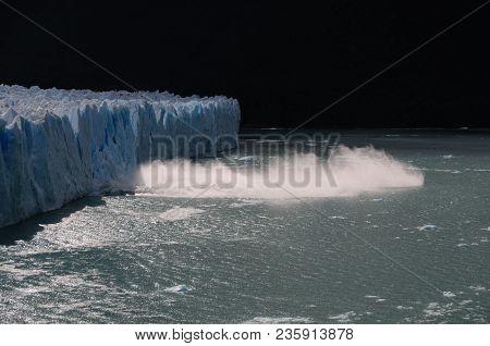 A Giant Piece Of Ice Breaks Off The Perito Moreno Glacier In Patagonia, Argentina