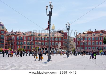 NICE, FRANCE - JUNE 4, 2017: A view of the Place Massena square in Nice, France, the main public square in the famous city of the French Riviera, with the fountain Fontaine du Soleil in the background