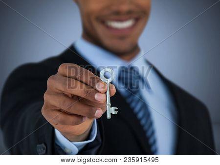 Man Holding key in front of vignette