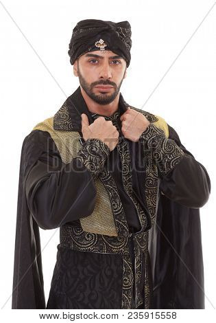 Handsome strong courageous man in oriental costume stands on a white background.