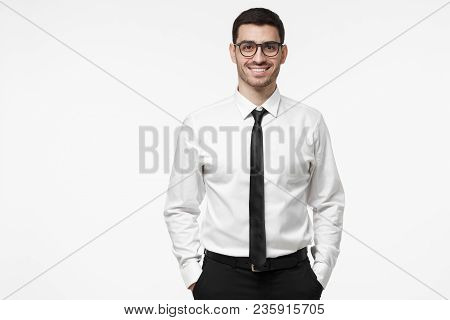 Young Contemporary Intelligent Executive Business Man Isolated On Grey Background. Copy Space For Yo