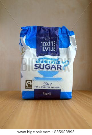 Bracknell, England - April 13, 2018: Part Consumed One Kilo Bag Of Tate & Lyle Granulated Sugar On A