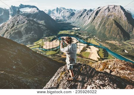 Man Taking Photo By Smartphone Standing On Cliff Enjoying Aerial Mountains Landscape Travel Active L