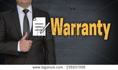 Warranty Concept And Businessman With Thumbs Up