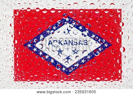 Flag Of American State Arkansas Behind A Glass Covered With Rain Drops. Patriots Day, Memorial Weeke