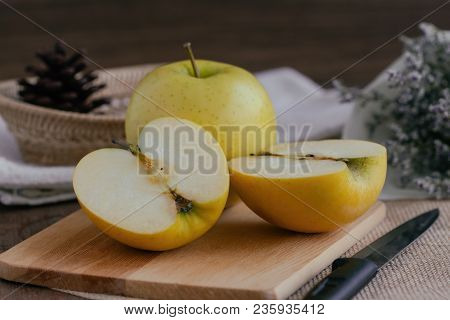 Cross Section Of Fresh Shinano Gold Apple From Japan. Cut An Apple Put On Wood Table With Copy Space