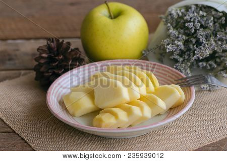 Fresh Shinano Gold Apple Cut And Sliced To Piece Ready To Eat On Plate. Delicious Yellow Apple Put O