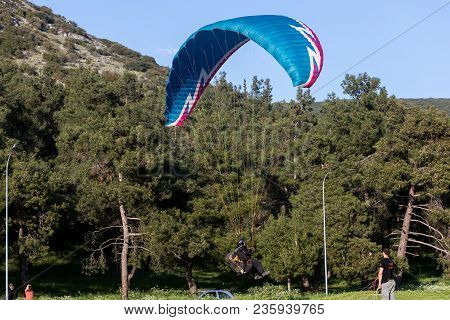 Paragliders Fly Against Blue Sky