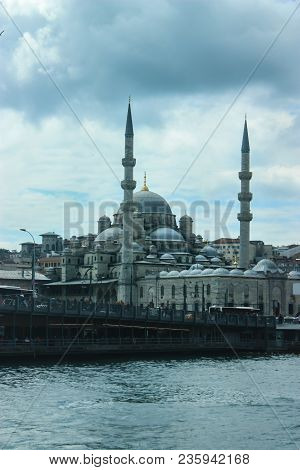 Beautiful Mosque In Istanbul As Seen From A Ferry With Cloudy Skies And Istanbul City Scape Sorround