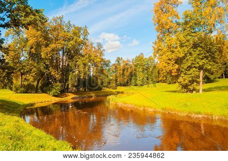 Autumn Landscape In Sunny Day. Golden Autumn Trees At The Bank Of The Autumn River - Colorful Sunny