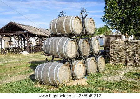 Russia, Ataman - 26 September 2015: Stacked Wine Barrels. Decoration Of The Barrels In The Village A