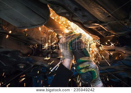 Repairing Of Corrugation Muffler Of Exhaust System In Car Workshop - Mechanic Cuts Old Muffler On Ca