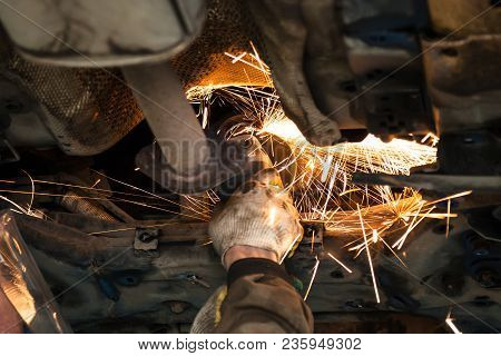 Repairing Of Corrugation Muffler Of Exhaust System In Car Workshop - Serviceman Cleans The Muffler P