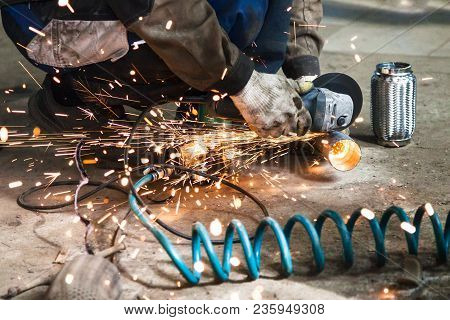 Repairing Of Corrugation Muffler Of Exhaust System In Car Workshop - Mechanic Cuts New Pipe For Corr