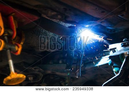 Repairing Of Corrugation Muffler Of Exhaust System In Car Workshop - Repairing Of A Silencer On Exha
