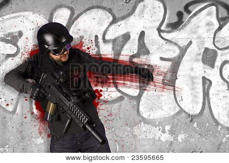 Assault troops, soldier wounded in action, grafiti background