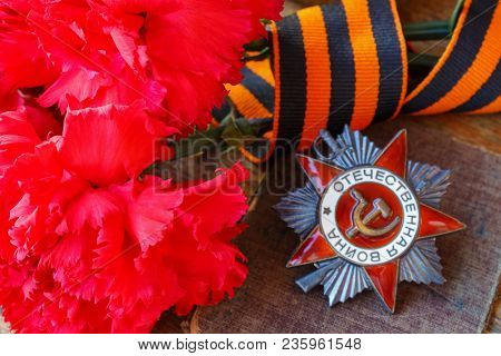 Red Carnations With St. George's Ribbon And Soviet Order Of Patriotic War (inscription Patriotic War