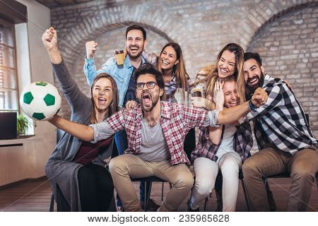 Happy Friends Or Football Fans Watching Soccer On Tv And Celebrating Victory. Friendship, Sports And