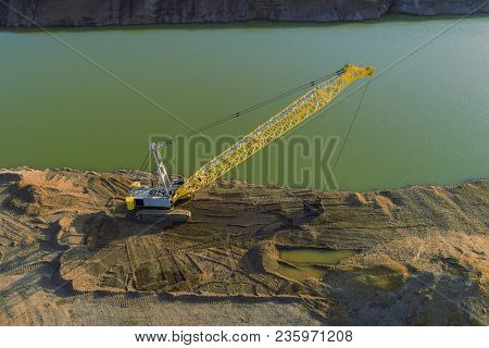 Drone Shot Of A Dredging Crane Near The Water