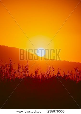 Scenic Sunset Or Sunrise Sun Rising Over Mountain Hill