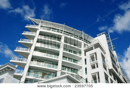 luxury apartment exterior with blue sky background