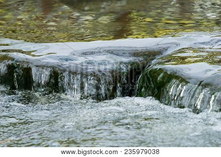 Close-up Of A Beautiful Flowing Creek. View To A Flowing Creek In Spring. River And Creek Background