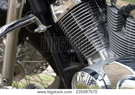 A Fragment Of A Motorcycle. Close-up Of A Motorcycle Engine, View Of The Silver Cylinders