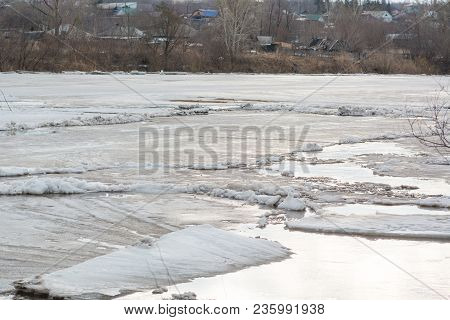 The Ice Melts On The River. The Icebreaker On The River. A Lot Of Ice Floats Along The River. The Ic