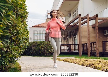 Happy Motivated Girl Runs, Wants To Lose Weight And Become Stronger, Outdoors