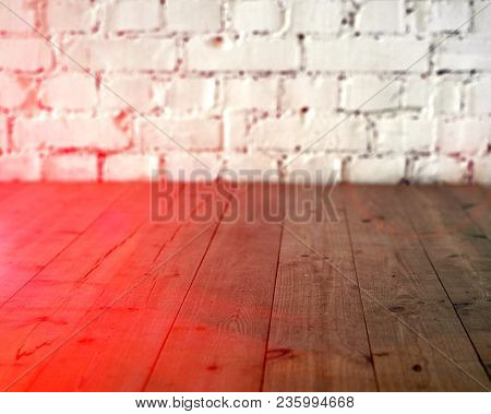 Black wooden floor and white brick wall background. Copy space with sun light halo. Toned. poster