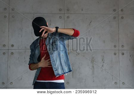Teenage Boyfriend Of Denim Jacket And Red Sweater Dances Hip-hop With Baseball Cap. Dynamics And Pla