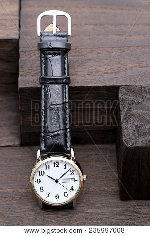 Wrist Watch With Leather Strap On Wooden Background