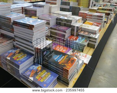 Tangerang, Indonesia - April 9, 2018: Stacks Of Fiction Books For Sale On Books Fair At Ice Bsd City
