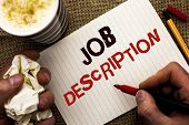 Writing note showing  Job Description. Business photo showcasing Document that establishes duties requirements exprerience written by Man Holding Marker Notebook Book the jute background poster