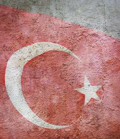 Stylized Image Of Flag Of Turkey Against The Old Wall Background