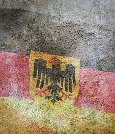 Stylized Image Of Flag Of Germany Against The Old Wall Background