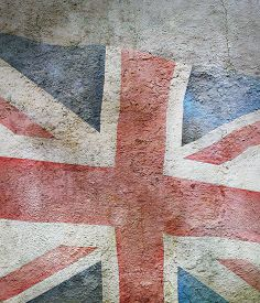 Stylized Image Of Flag Of United Kingdom Against The Old Wall Background