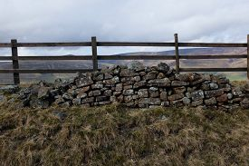 Ancient Fence With Pile Of Bricks On Mam Tor (derbyshire, England,uk)