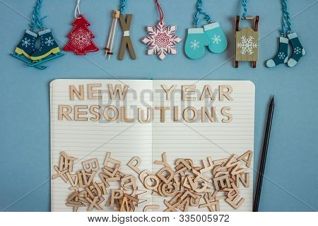 Christmass Decoration And Open Notebook For New Year Resolutions