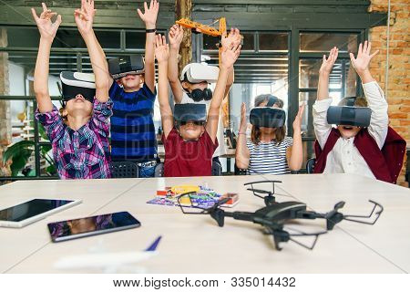 Korean Scientist With The Group Of Young Pupils With Laptop And Vr Headsets During A Computer Scienc