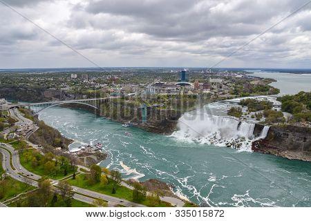Niagara Falls, Usa - May 16 2016 : High View Of Niagara Falls Flowing Over The Rocks And Onto The Ri