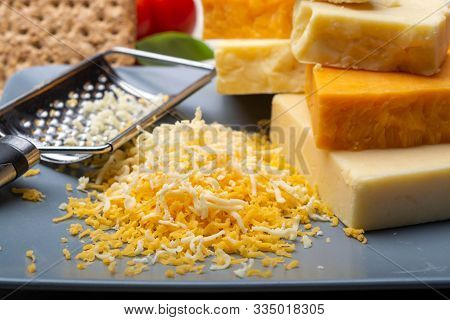 Cheese Collection, Matured And Orange Original British Cheddar Cheese In Blocks And Grated Served On