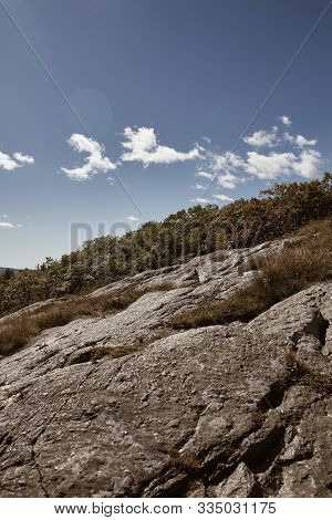 Hiking Over Bedrock On The Summit Of Mt Battie At Camden Hills State Park In Camden, Maine.