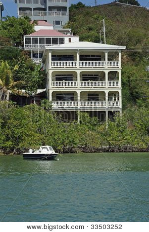 Boat and house in the Caribbean