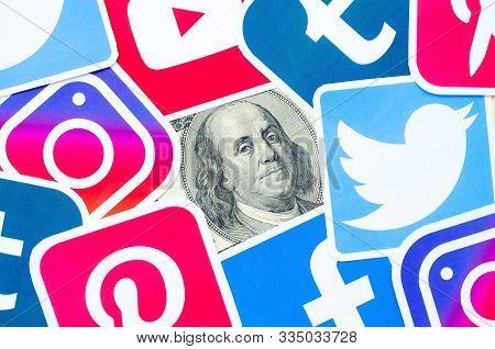 Benjamin Franklin Hundred Dollars Bill Portrait With Printed Logo Of Many Social Networks. Facebook