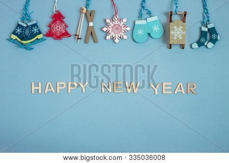 Christmass Decoration On Blue Paper Craft Background. Words Happy New Year. Copy Space