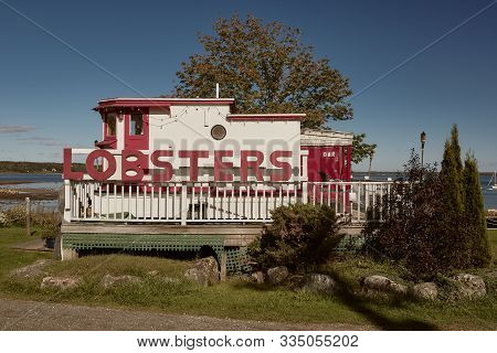 Lincolnville, Maine - September 27th, 2019:  Red And White Wooden Lobster Shack On Lincolnville Beac
